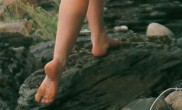 Barefoot on a rock