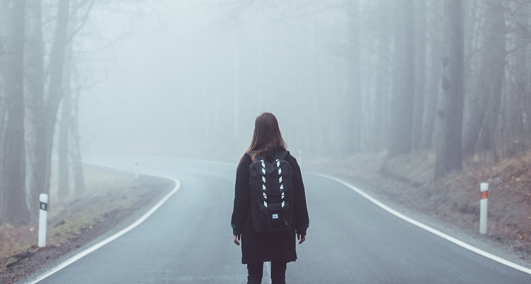 Girl on road in fog